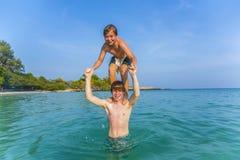 Boys have fun playing piggyback Stock Images