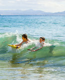 Boys have fun  with their boogie boards Stock Photo