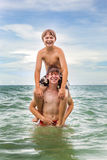 Boys having fun in the beautiful clear sea Royalty Free Stock Images