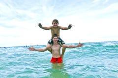Boys having fun in the beautiful  sea Royalty Free Stock Photography