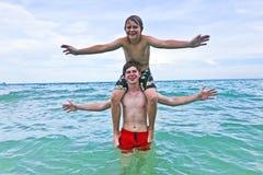 Boys having fun in the beautiful sea Stock Image