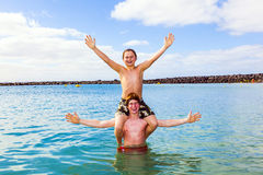 Boys having fun in the clear sea Royalty Free Stock Photography
