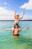 Boys having fun in the clear sea Stock Images