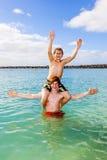 Boys having fun in the clear sea. Boys having fun in the beautiful clear sea playing piggyback Stock Images