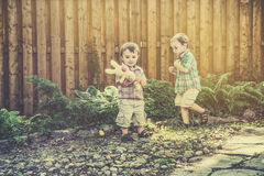 Boys Having Fun on an Easter Egg Hunt - Retro Royalty Free Stock Photos