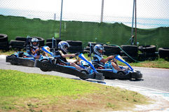 Boys having fun on a go cart. Out of track jump Royalty Free Stock Image
