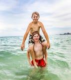 Boys having fun in the ocean Royalty Free Stock Photography