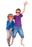 Boys having fun wearing 3D glasses Stock Images