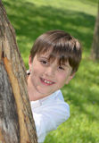 Boys Head Behind Tree Royalty Free Stock Image