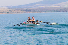 Regatta Rowing Teenagers Doubles  Royalty Free Stock Photos