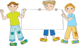 Boys holding blank placard Royalty Free Stock Image