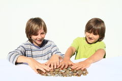 Boys holding money Royalty Free Stock Images