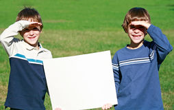Boys Holding Sign Stock Photography