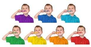 Boys in iridescent shirts show with toothbrush Royalty Free Stock Image