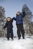 boys jump in winter outdoors Stock Photo