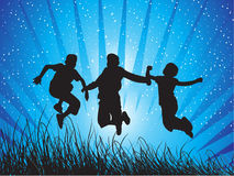 Boys jumping with joy. Young people having fun and being active Stock Image