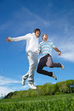 Boys jumping in park Stock Photos