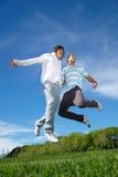 Boys jumping in park Stock Photos