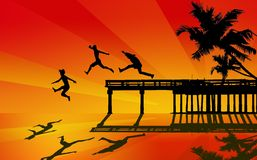 Boys jumping from pier Royalty Free Stock Photo