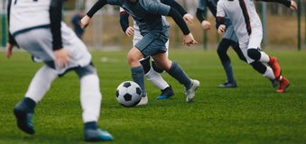 Boys Juniors in Action Play Football Soccer Match. Running Footballers Athletes stock photo