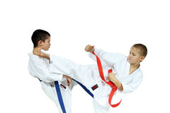 Boys in karategi are beat blows kicks Stock Photography