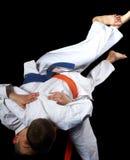 Boys in karategi are training throw uki-goshi Stock Photo
