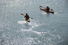 Boys in kayaks. Royalty Free Stock Photo