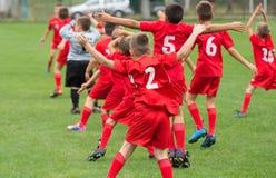 Boys kicking ball. Boys kicking football on the sports field royalty free stock image