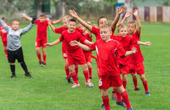 Boys kicking ball. Boys kicking football on the sports field stock photography