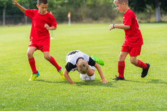 Boys kicking ball Stock Image