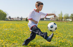 Boys kicking football Stock Image