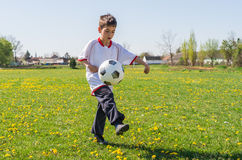 Boys kicking football Stock Photography