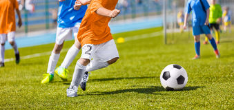 Boys Kicking Football Mach. Soccer Children Tournament Competition Royalty Free Stock Photo