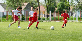 Boys  kicking football Royalty Free Stock Image