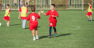 Boys kicking football Royalty Free Stock Photo