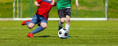Boys kicking soccer ball. Youth soccer game for kids. Soccer tournament Stock Photos