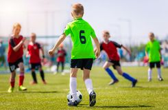Boys Kicking Soccer Match on Grass. Youth Football Game. Children Soccer Competition. Boys Kicking Soccer Match on Grass. Youth Football Game. Children Sport royalty free stock photos