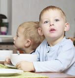 Boys kids children eating corn flakes breakfast Stock Image