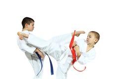 Boys in kimono are training beat blows kicks Stock Photo