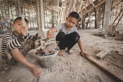 Boys labor work in the construction site, Against child labor royalty free stock photography