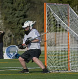 Boys Lacrosse Goalie block Royalty Free Stock Photo