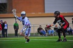 Boys Lacrosse long stick. March 19, 2011 OHSLA (Oregon High School Lacrosse Association) Hillsboro's HillHi V HS V Harney Oregon HS V. Harney #13 reaches to Stock Photo