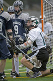 Boys lacrosse after the play Stock Photos