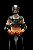 Boys lacrosse player. Isolated on a black background a high school boys lacrosse player with his protective gear on holds his stick with the ball Royalty Free Stock Photography