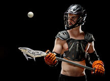 Boys lacrosse player keeping his eye on the ball stock photos