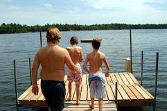 Boys at lake Stock Photos
