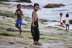 Boys from Lamalera,Indonesia. Little boy from Indonesia brings caught him fish.The village of Lamalera on the Indonesian island of Lembata is the last place on stock photo