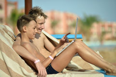 Boys with laptop Stock Photography