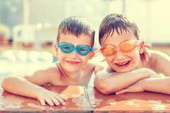 Boys laughing in pool. Vintage style stock images