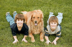 Boys Laying with the Dog Royalty Free Stock Photography